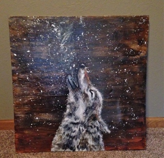 Stained and refinished a wood board and then painting the wolf with acrylic paint.